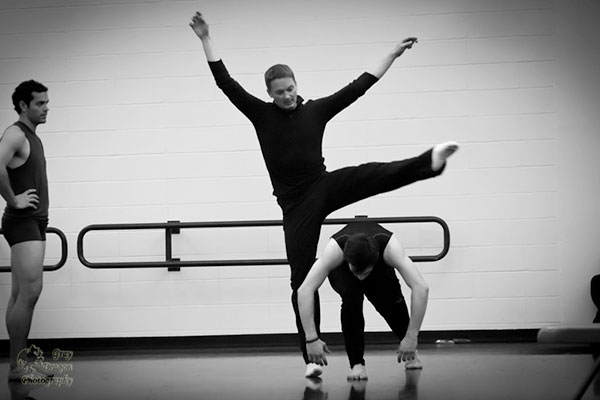 caption: Guest choreographer Brock Clawson working with the DK dancers. Photo by Mike Drury